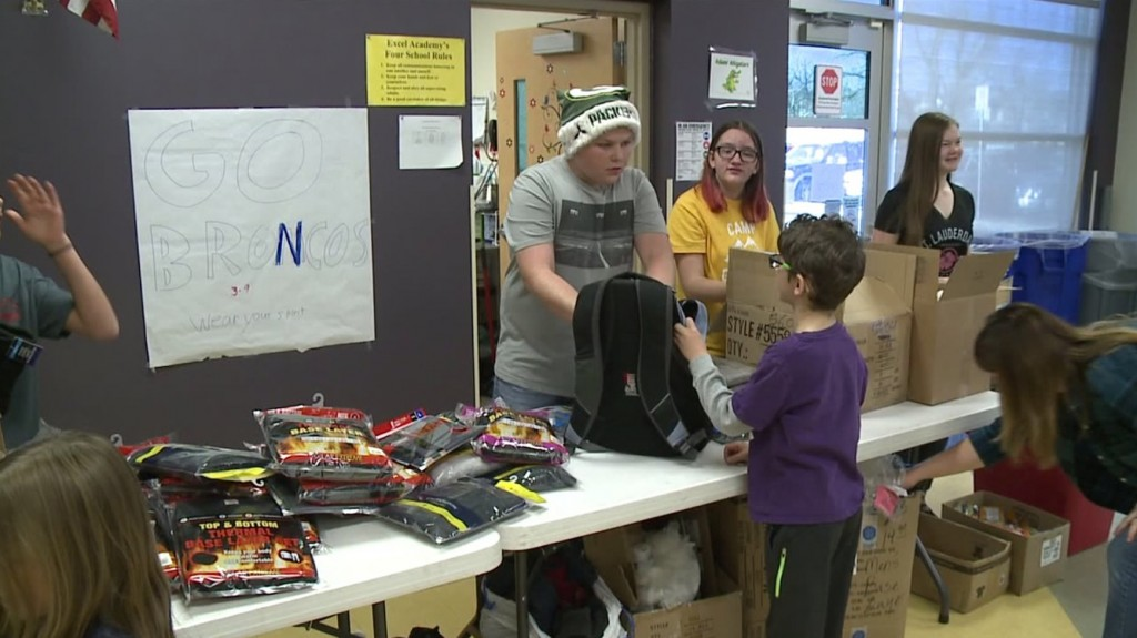 Backpacks of Mercy-students stuffing backpacks for kids